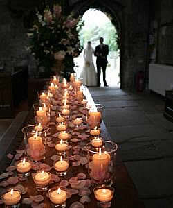 Twinkling candles adorn the church
